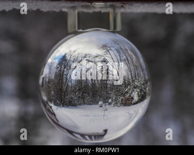 A real snow globe perched on a wintry porch in the USA. - Stock Image