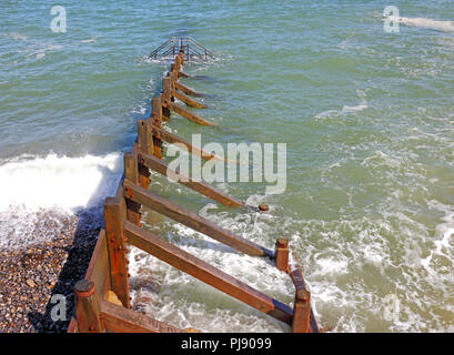 A view of a wooden breakwater at high tide on the North Norfolk coast at Cromer, Norfolk, England, United Kingdom, Europe. - Stock Image