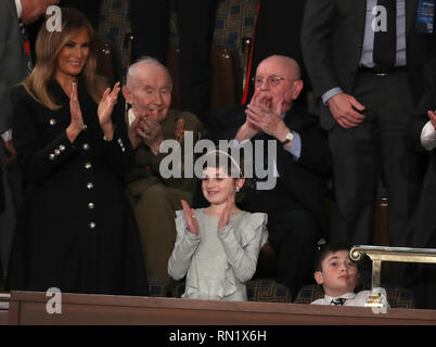 February 5, 2019 - Washington, District of Columbia, U.S. - Grace Eline, who was diagnosed with Germinoma, a germ-cell brain tumor, applauds after being introduced by United States President Donald J. Trump during his second annual State of the Union Address to a joint session of the US Congress in the US Capitol in Washington, DC on Tuesday, February 5, 2019. Grace recently finished chemotherapy and currently shows no evidence of the disease. First lady Melania Trump applauds at left. Joshua Trump, a sixth grader who was bullied at school because of his last name is pictured at right (Cre - Stock Image
