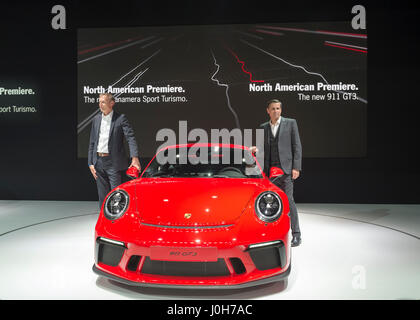 Manhattan, USA. 12th Apr, 2017. R-L, KLAUS ZELLMER, President and Chief Executive Officer of Porsche Cars North - Stock Image