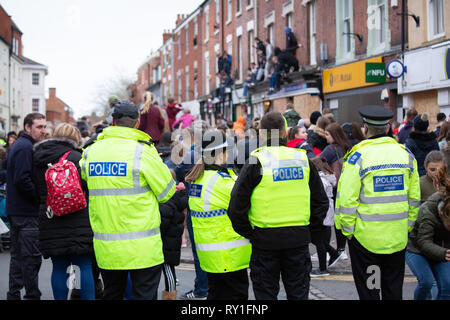 Police look on during the last moments of the Atherstone Ball game. A tradition dating back to the 12th century. - Stock Image