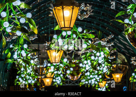 Christmas lights and decorations at the Covent Garden market in London at night - Stock Image