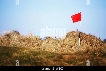 Red flag on Carnoustie Golf Course, Angus, Scotland - Stock Image