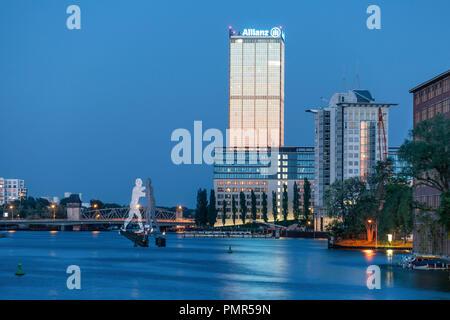 River Spree, Office buildings, Aliianz tower, Treptowers, Monecule Man, Berlin , Germany - Stock Image