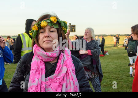 Stonehenge, Amesbury, UK, 21st  June 2018,   Woman in a floral headband with closed eyes at the summer solstice  Credit: Estelle Bowden/Alamy Live News. - Stock Image