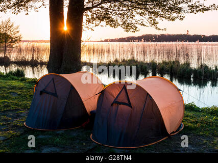 Two small tents, campsite, sunset, lake Schwerin, southern beach, Schwerin, Germany - Stock Image
