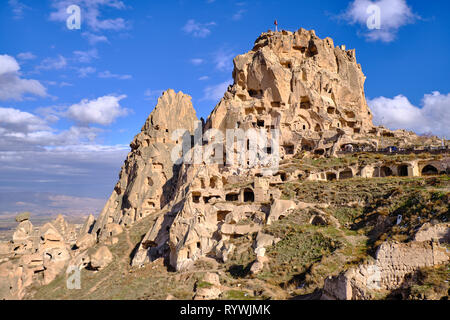 Uchisar Castle in Cappadocia, on a biright winter day, with blue sky and puffy clouds - Stock Image