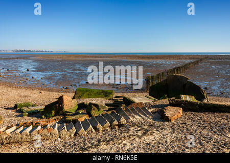 World War Two Pillbox or gun emplacement, fallen into the sea due to coastal erosion. Cudmore Grove Country Park, East Mersea, Essex. - Stock Image