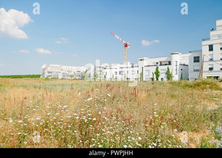 Seine et Marne. Serris. Montevrain. New city. Buildings under construction. Fileds. - Stock Image
