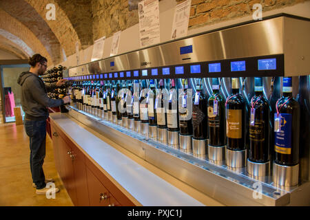 An enoteca  in the town of Barolo is giving visitors or tourists the possibility to taste the local wines at a reasonable fee - Stock Image