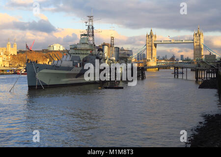 HMS Belfast, a WW2 cruiser now a museum berthed on the River Thames close by Tower Bridge, London - Stock Image