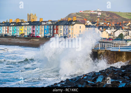 Aberystwyth Wales UK, 13 Jan 2019 UK Weather: A blustery day in Aberystwyth on the west wales coastline, with winds gusting up to gale force at times, driving huge waves into the seafront  promenade at high tide .  photo credit: Keith Morris / Alamy Live News - Stock Image