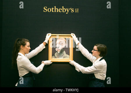 London, UK. 21st June, 2019. Sotheby's technicians with a 'Francis Bacon, Self Portrait', 1975, Oil on Letraset on canvas. Estimate: £15,000,000-20,000,000 at the Sotheby's Contemporary Art Auction preview for the Evening sale on 26 June Credit: amer ghazzal/Alamy Live News - Stock Image