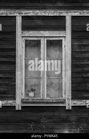 Rustic barn window in an old Swedish farm in northern Sweden - Stock Image