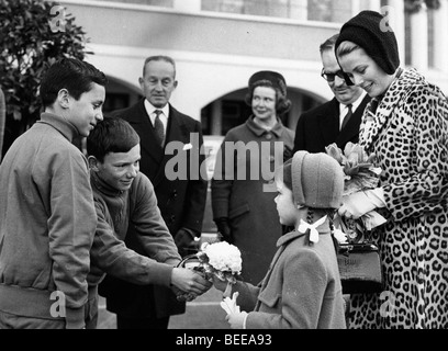 Grace Kelly, Princess of Monaco, watches as her daughter Caroline, Princess of Hanover, is presented with flowers. - Stock Image