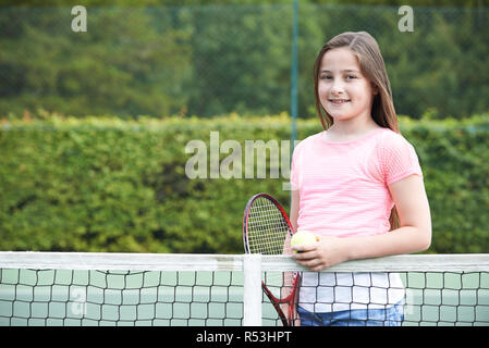 Portrait Of Young Girl Playing Tennis - Stock Image