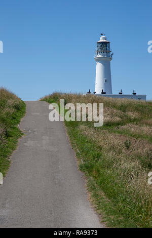 Flamborough Head lighthouse viewed from the Selwicks Bay coastal side of the headland - Stock Image