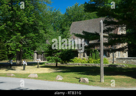 Park employees applying fertilizer to the lawn at Jordan Pond Gate House, Acadia National Park, Maine, USA. - Stock Image