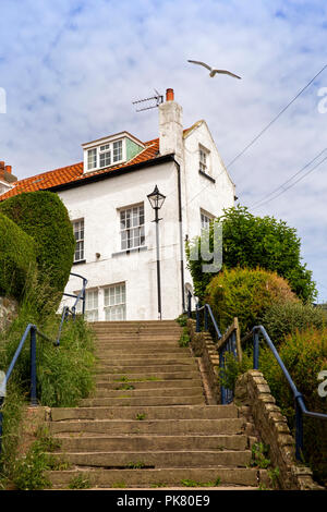 UK, England, Yorkshire, Filey, steps up to Queen Street from seafront - Stock Image