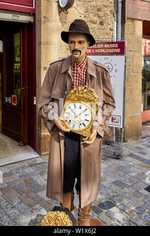 Creepy figure outside the watch and clock museum in Fougères in Brittany, France - Stock Image