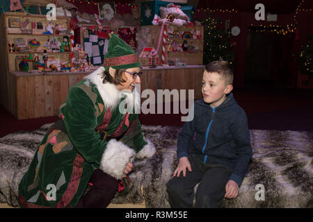 Eden Project, Cornwall, UK. 23rd November 2018.  'Alfie meets Elfie'  The Eden project's Christmas celebrations get underway this weekend, with light and shadow experience in the biomes, ice skating and a magical experience with Santa and his Elves. 9 year old Alfie meets Elfie talking about his plans for Christmas. Credit: Simon Maycock/Alamy Live News - Stock Image