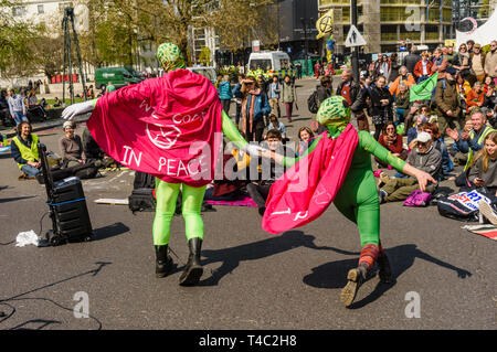 London, UK. 15th April 2019. Extinction Rebellion environmental campaigners close the whole area around Marble Arch to traffic, with a stage and performers, various tents and activities and road blocks on the streets leading to the gyratory system. Many had been there overnight and they intend to stay and block traffic until the government takes necessary action on the global climate and ecological emergency. Credit: Peter Marshall/Alamy Live News - Stock Image
