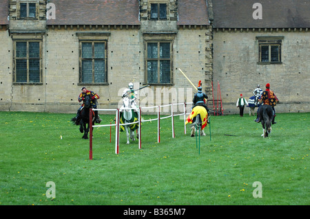 Knight Jousting in front of castle - Stock Image