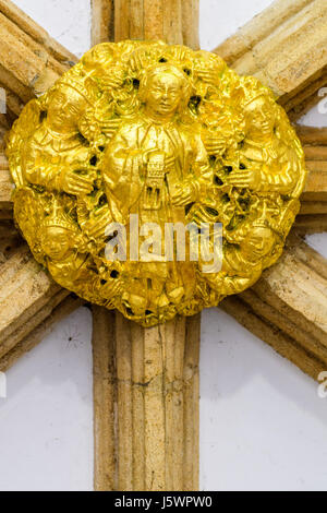Gilded boss above the porch on the west entrance to the medieval christian cathedral at Peterborough, England. - Stock Image