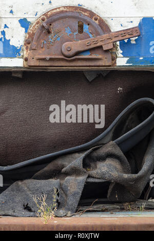 Close up detail of fly tipping including complete articulated vehicle trailer, Heathrow / Colnbrook, England - Stock Image