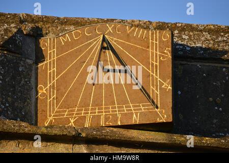 Sundial on St Peter's Church, Hook Norton, Oxfordshire - Stock Image