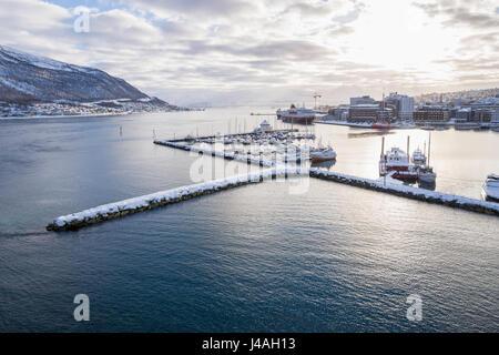 View Southwest from Tromsø bridge (Tromsøbrua) over Tromsøysundet, in the city of Tromsø, Norway. - Stock Image
