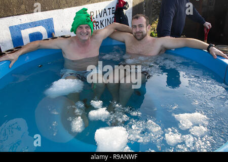 Skibbereen, West Cork, Ireland, December 22nd 2018. A fine sunny mild day assisted Paul Gross and Paul Shilling in enduring the Ice Bath Christmas Challenge for a local charity.  Credit: aphperspective/Alamy Live News - Stock Image