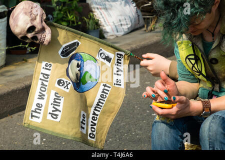 London, UK. 17th April 2019. The world is dying - The government is lying'. Two days after Extinction Rebellion closed Waterloo Bridge turning it into a 'Garden Bridge' it remains closed to traffic despite a couple of hundred arrests. Activities continue on the bridge with new protesters arriving. Credit: Peter Marshall/Alamy Live News - Stock Image