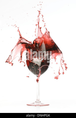A splashing and breaking glass of red wine. - Stock Image