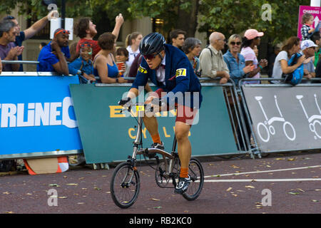 A cyclist racing along The Mall with onlooking crowd, Brompton World Championships 2018, London, UK - Stock Image