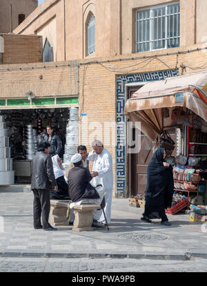 Yazd, Iran - March 7, 2017 : street scene in central Amir Chakhmaq square, people talking in front of shops - Stock Image