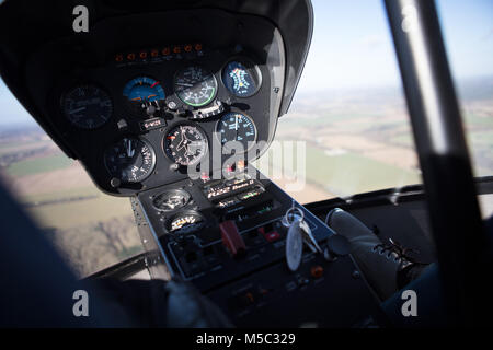 An internal view of a Robinson R22 in flight over the United Kingdom - Stock Image