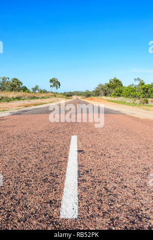 Middle of the road on the Savannah Way at the beginning of a narrow ribbon road stretch, Queensland, QLD, Australia - Stock Image