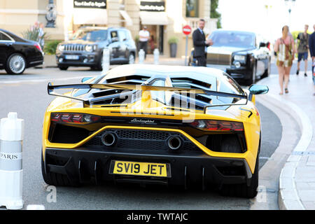 Monte-Carlo, Monaco - June 21, 2019: Black And Yellow Lamborghini Aventador SVJ Roadster (Rear View) Parked In Front Of The Hotel De Paris Monte-Carlo - Stock Image