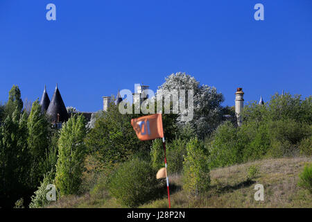 French golf course with flag and chateau, quintessential picture of golf in France. - Stock Image