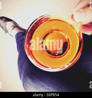 Woman drinking a cup of tea - Stock Image