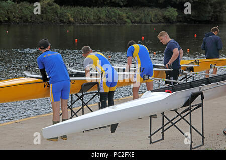 WRC men launching a quad, at Warrington Rowing Club 2018 Summer regatta, Howley lane, Mersey River, Cheshire, North West England, UK - Stock Image
