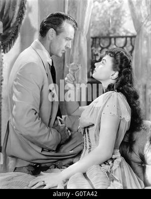 Gary Cooper and Ingrid Bergman / Saratoga Trunk / 1945 directed by Sam Wood (Warner Bros. Pictures) - Stock Image