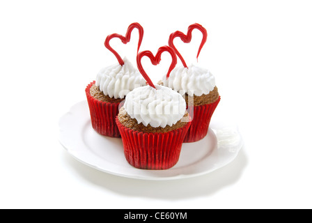 Chocolate cupcakes with vanilla frosting for Valentine's day. - Stock Image