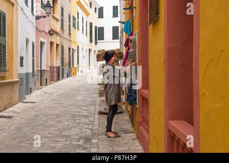 A woman shopping for souvenirs in Ciutadella, Menorca - Stock Image