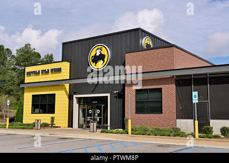 Buffalo Wild Wings casual dining family restaurant and sports bar, front exterior entrance, in Montgomery Alabama USA. - Stock Image