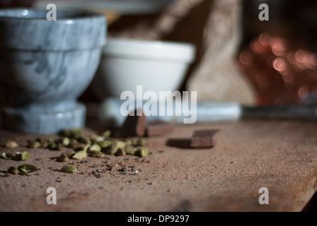Cardamom and Chocolate for making truffles ganache - Stock Image