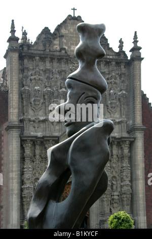 Modern Statue Outside The Metropolitan Cathedral, Zocalo Square, Plaza de la Constitucion, Mexico City, Mexico - Stock Image