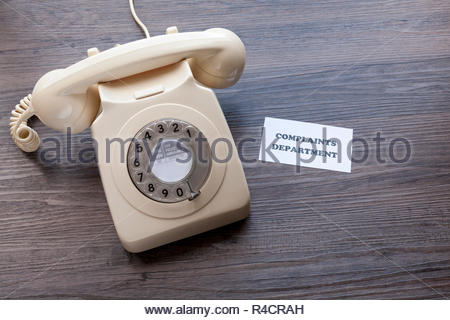 Retro telephone with note - Complaints Department - Stock Image