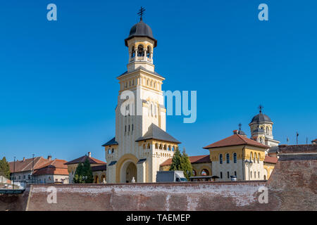 View to the Bell tower and Coronation Reunification Cathedral in Alba Iulia city, Romania. A church in Alba Iualia, Romania. - Stock Image